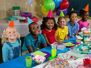 group of kids at birthday party wearing party hats